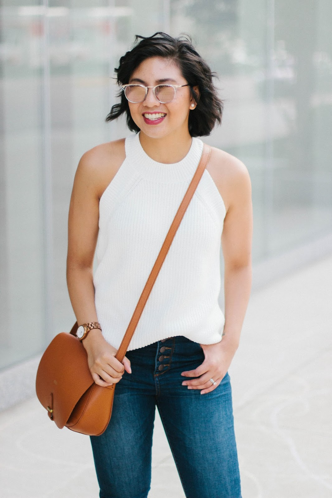 Reasons why transitional outfits like wearing sleeveless sweaters are great for Fall