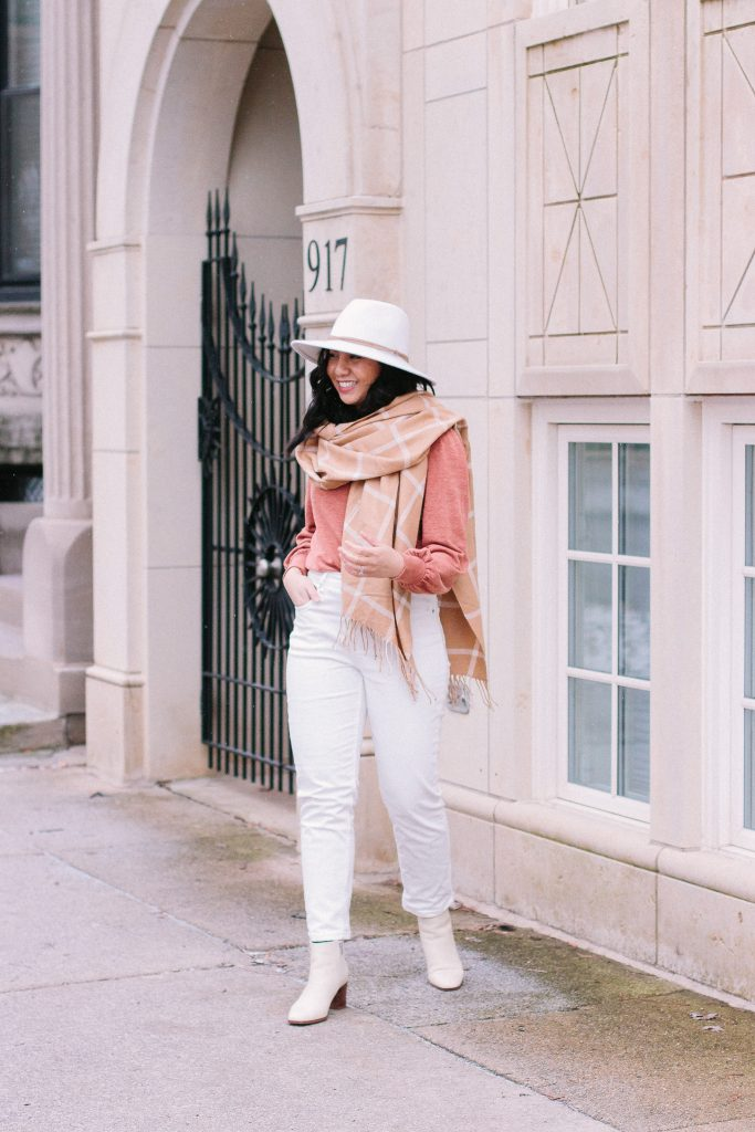 Go-To Accessories to Elevate Winter Outfits are rancher hats and oversized scarf.
