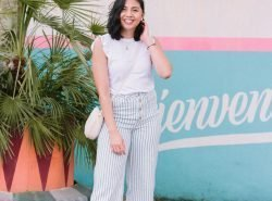 Rach is wearing a spring outfit - white tee and striped blue pants