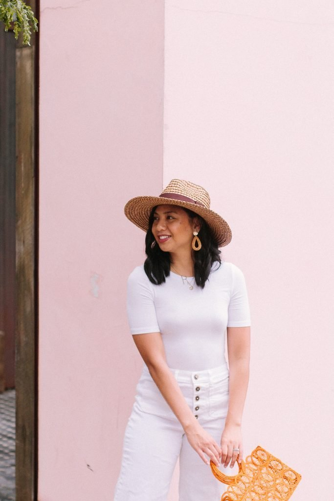 a girl in a white shirt and white pants