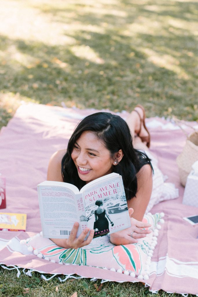What I Read In August Book Review told by this girl sitting on a pink towel